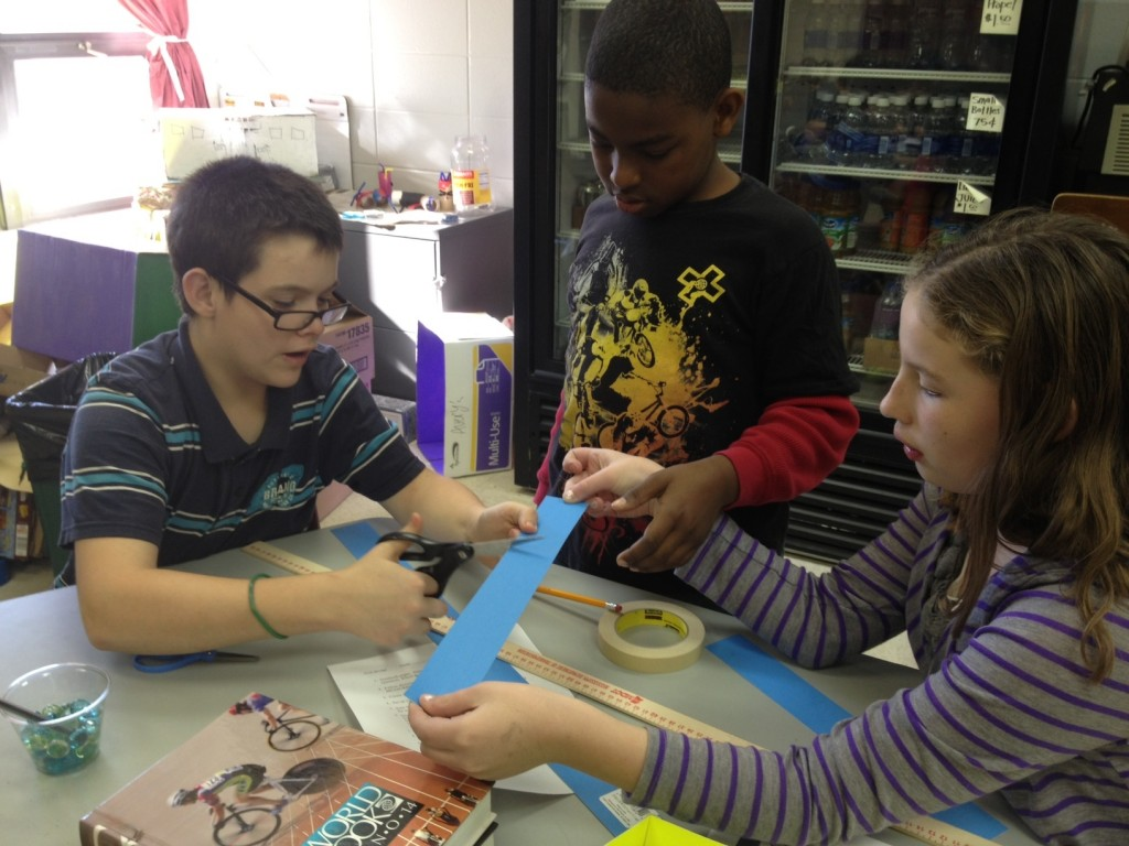 NAMS students Jason, Joshua, and Kate work on a bridge building activity.