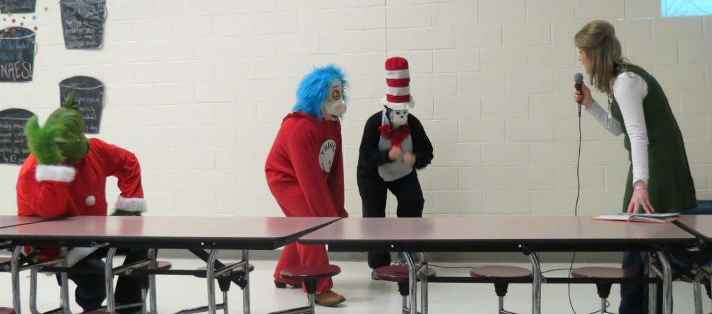 NAES Principal Windy Faulkner interacts with some famous Seuss characters during a Dr. Seuss storytime.