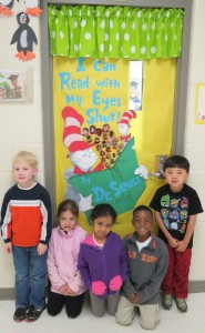 Pictured:  Kindergarten students in Mrs. Bridget Spencer's class display their winning decorated door.
