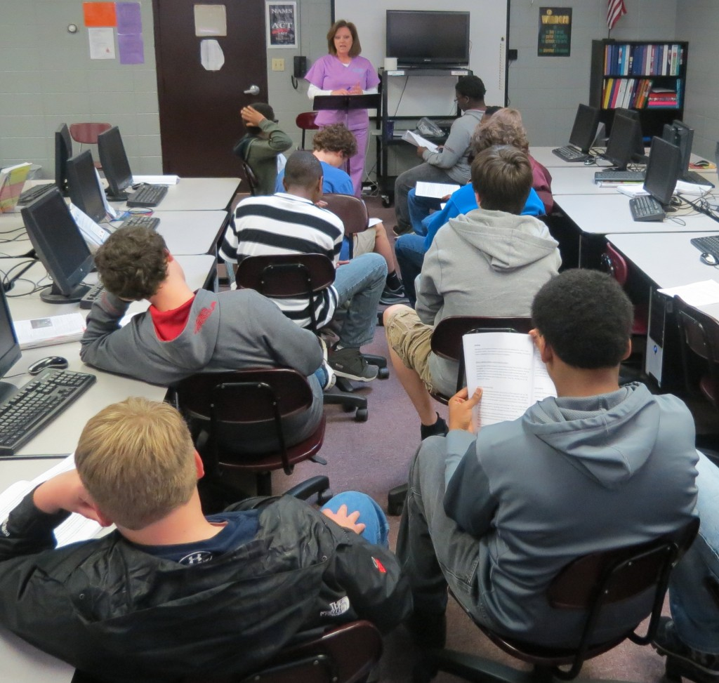 "Tammie Reeder, Health Services Coordinator for New Albany Schools and an abstinence only education instructor, presents a ""WAIT Training"" lesson to a group of seventh grade boys."