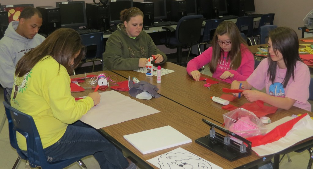 Students in Kimberly Langley's Early Childhood II class at New Albany High School make preparations for the craft booth that will be available to children at the EXCELEBRATION.