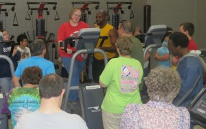 Lori Beth Elder demonstrates the safe and proper way to work out on an elliptical.