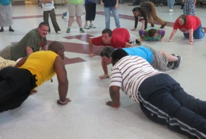"A group of New Haven clients challenged ""AJ"" to a push-up contest."