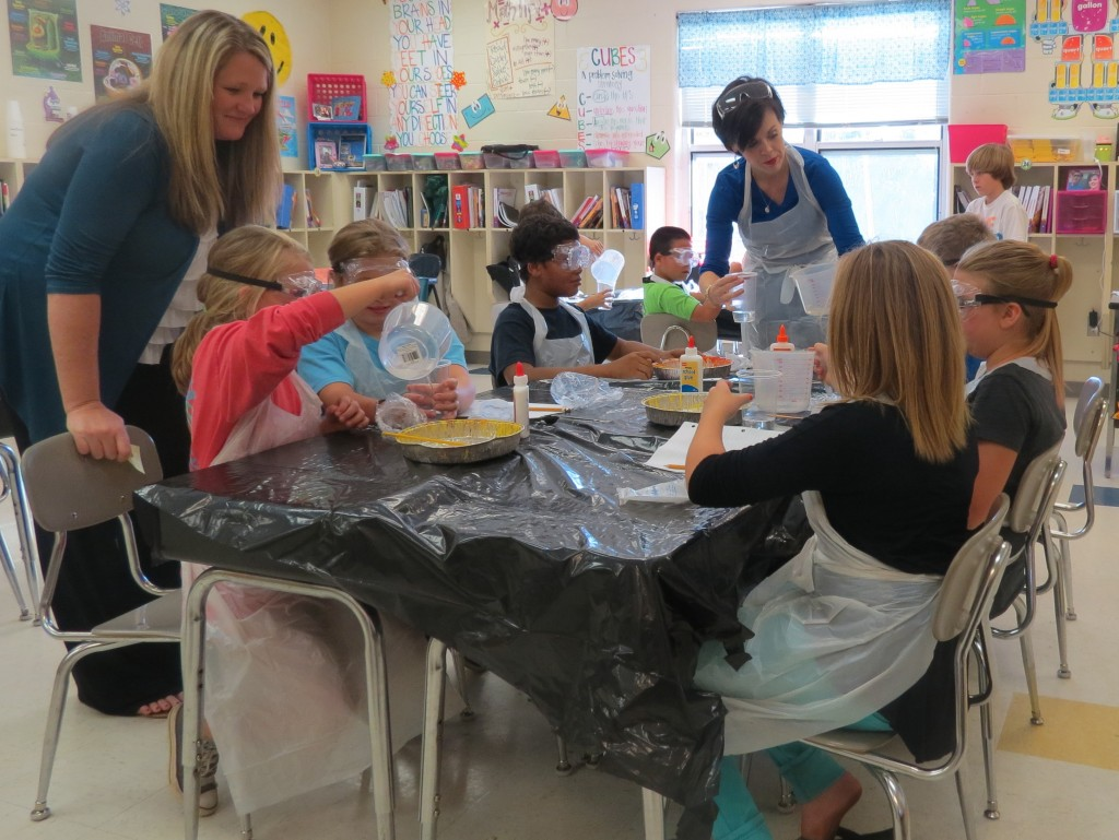 NAES Site Coordinator Laura Reedy & Enrichment Instructor Dawn Stroupe  conduct science experiments for 21st CCLC participants during a recent afterschool session.