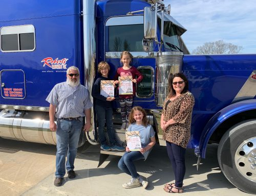 Roberts Trucking Donates Books to NAES