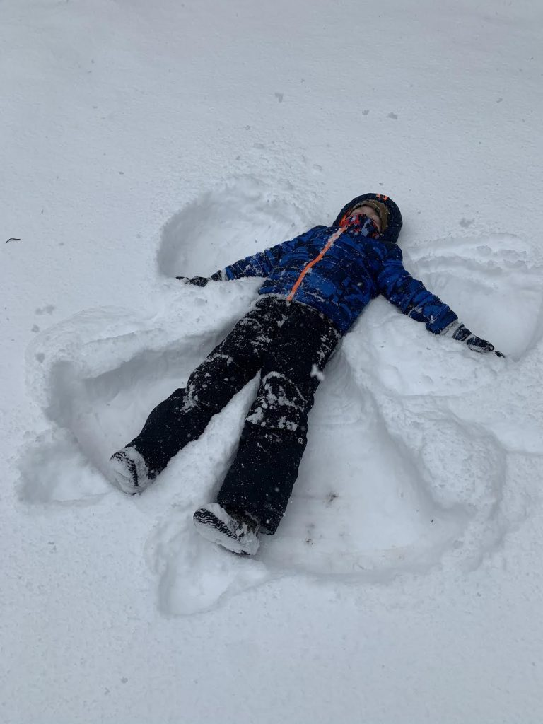 Student making a snow angle