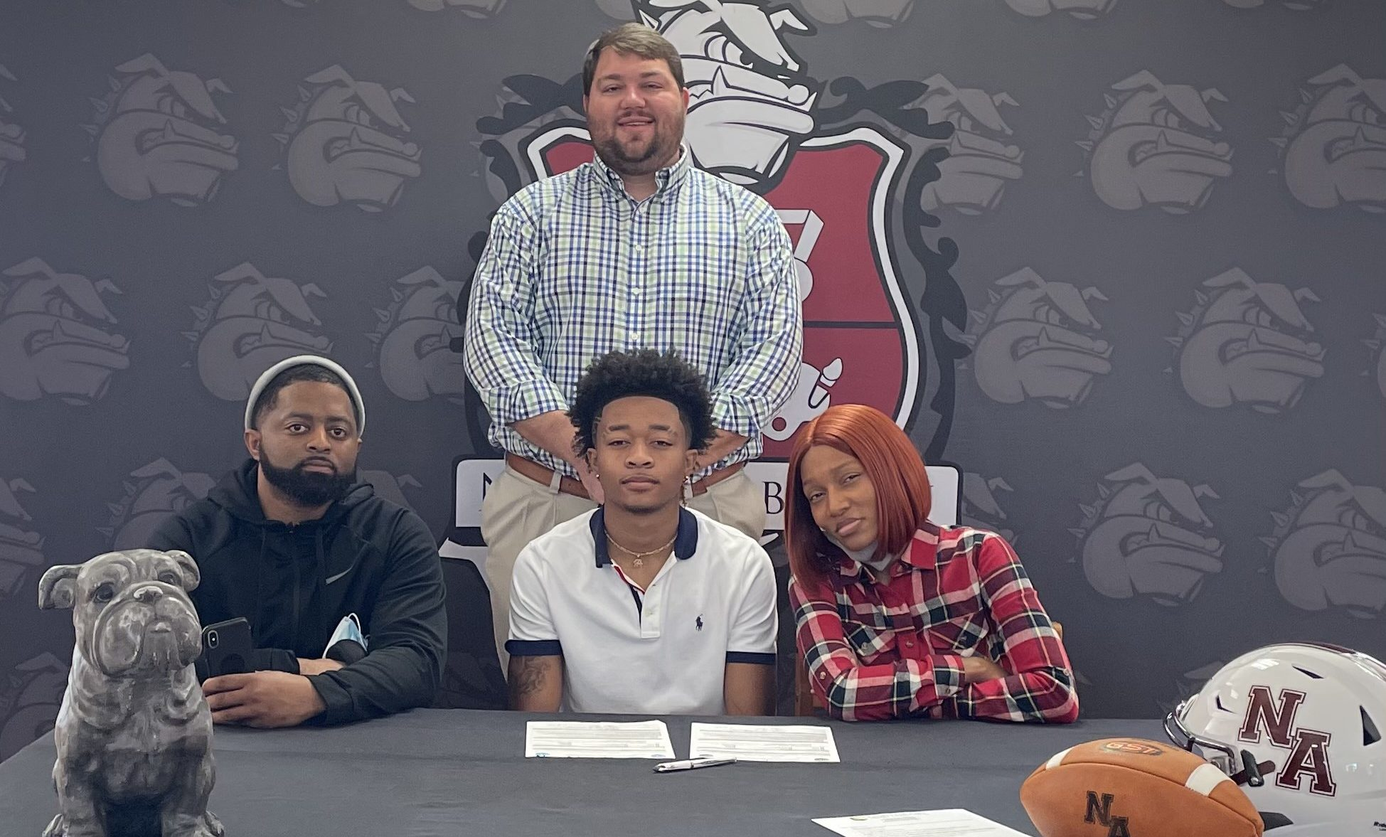 Isaiah Cohran with family and Coach Stubblefield - signing to play community college football