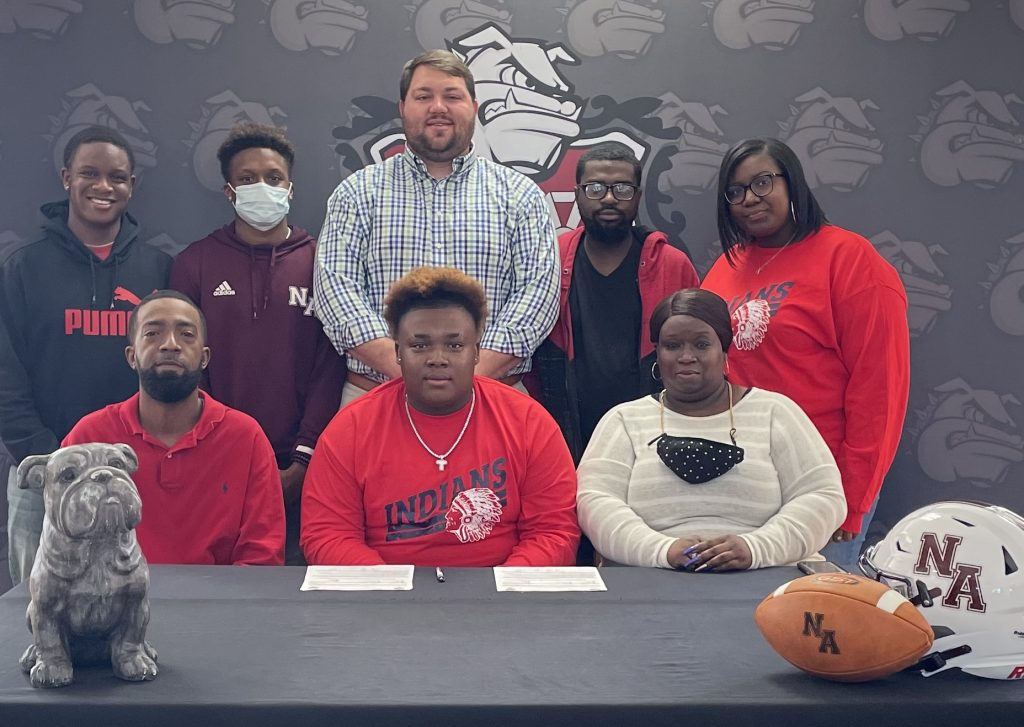 Congrats to our NAHS Football Signees! New Albany High School senior Bulldog football player Tre Dean signed to play football with Itawamba Community College on Wednesday, February 3. Pictured are front row l-r: Donnie Ford, Tre Dean, Natoya Chaney; back row l-r: Arlando Gates, Olando Gates, NAHS Head Football Coach Cody Stubblefield, Kenyatta Chaney, Takeya Dean New Albany High School senior Bulldog football player Isaiah Cohran signed to play football with Northeast Mississippi Community College on Wednesday, February 3. Pictured are front row l-r: Anthony Cohran, Isaiah Cohran, Tiffany Foy; back row: NAHS Head Football Coach Cody Stubblefield.