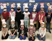 Mrs. Duncan's kindergarten class shows off their Cat in the Hat hats and bowties