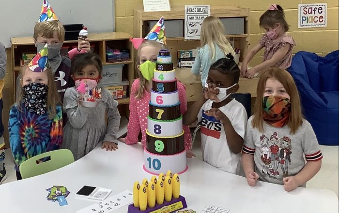 PreK students participate in learning centers related to Dr. Seuss' birthday