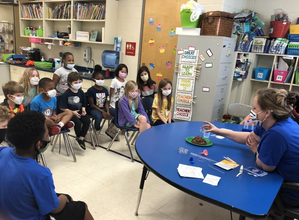 1st grade students participate in a science experiment