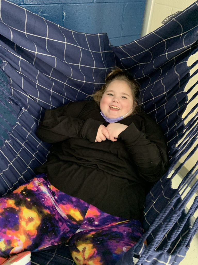 Student uses sensory swing at NAES