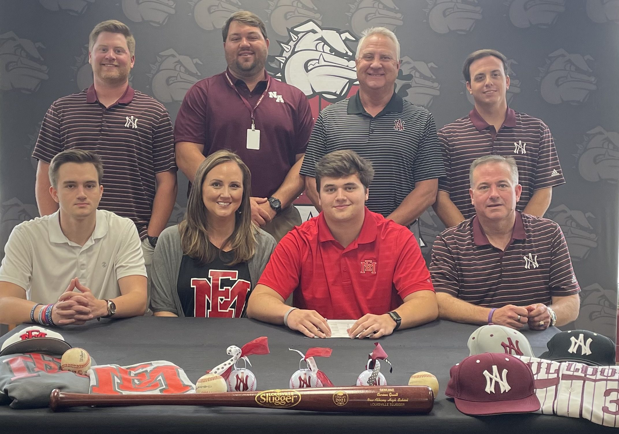 Carson Gault is surrounded by family and coaches as he signs to play baseball for East Mississippi Community College.