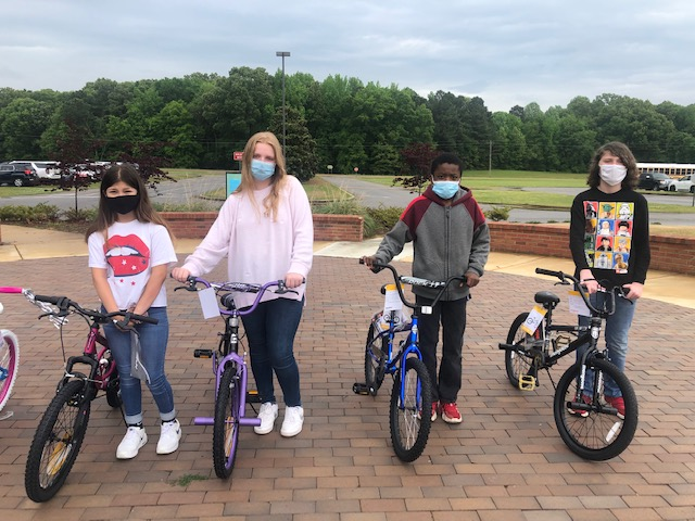 Pictured are writing contest winners with their bike: Picture 2: (l-r) Celeste Sandoval, Ever Raine Robinson, Jonathon Woods, and Zeke Brooks
