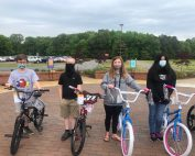 Writing Contest Winners with their bike: Colton Roberts, Jason Ross, Morgan Pierce, and Natalie Aguilar